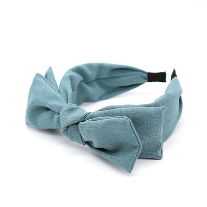 Double bow fabric covered headband in denim blue