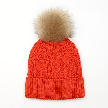 Orange cable knit lined hat with pom pom