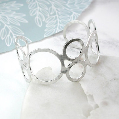 Silver plated open circles bangle with worn finish