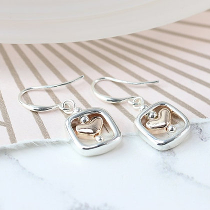 Rose gold plated heart earrings in silver plated frames