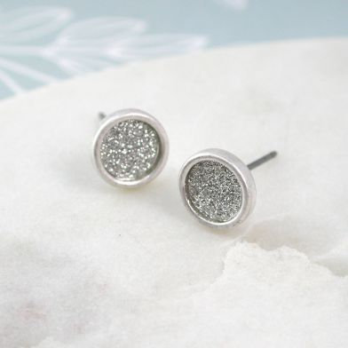 Worn silver plated glitter circle stud earrings