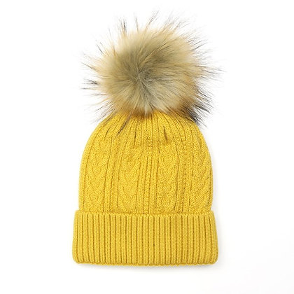 Winter hat in mustard yellow with a natural faux fur pom pom