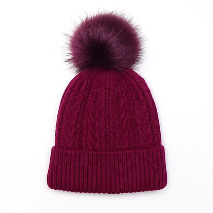 Wool mix cable knit hat in magenta with a matching faux fur bobble