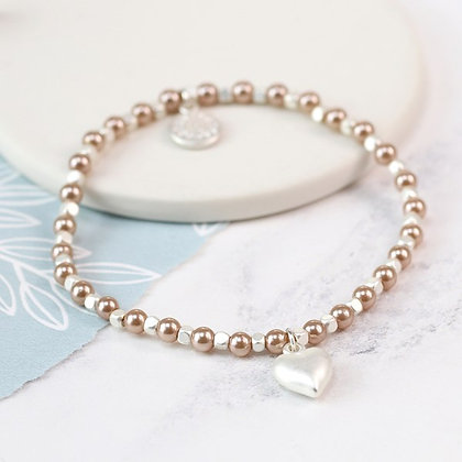 Pink faux pearl and silver plated matt heart bracelet