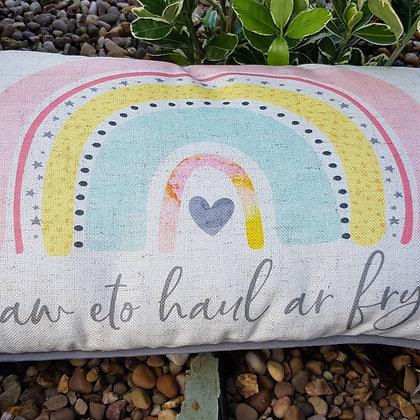 """""""Daw eto haul ar fryn"""" - Rainbow welsh cushion"""