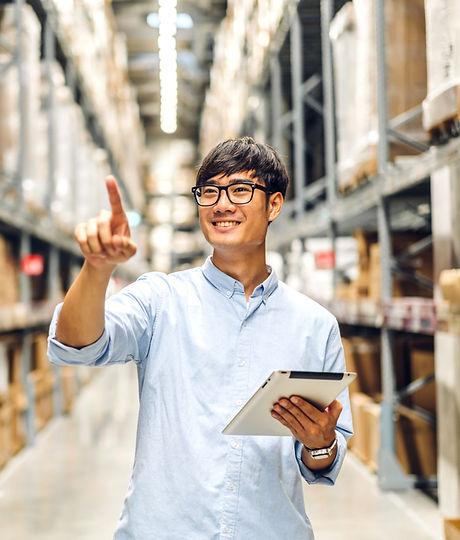 Asian Man in Warehouse.jpg