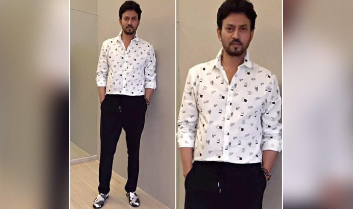 Irrfan posing for a photograph wearing a swag outfit.