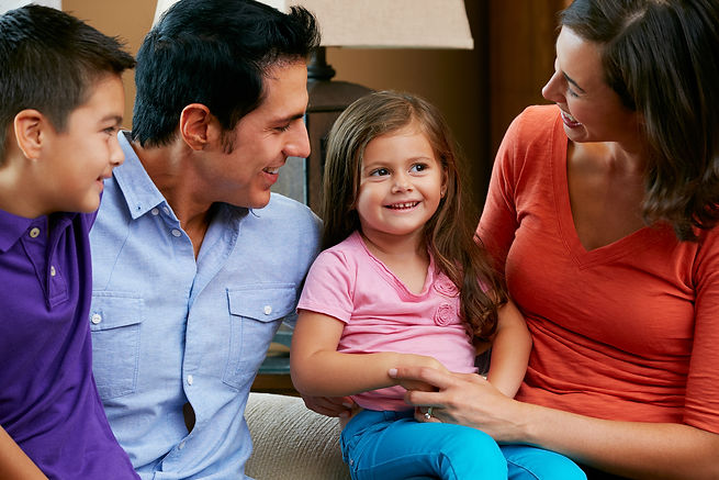 bigstock-Family-Sitting-On-Sofa-At-Home-
