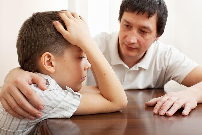 bigstock-Father-comforts-a-sad-child-P-2