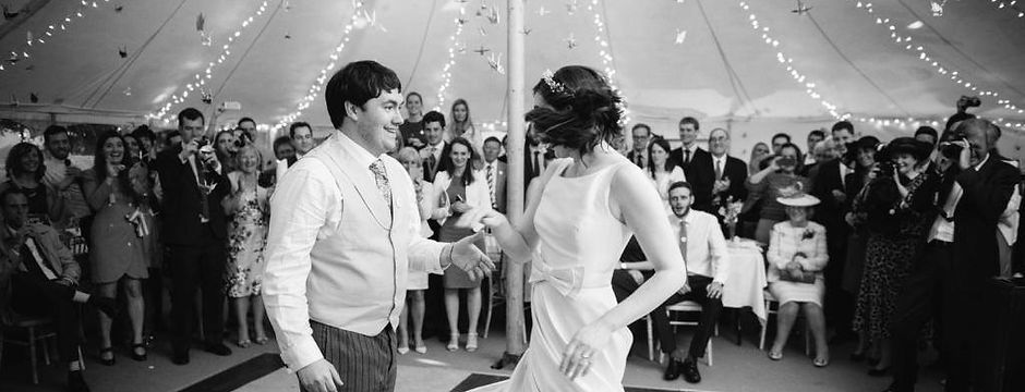 first dance couple perform in front of wedding guests