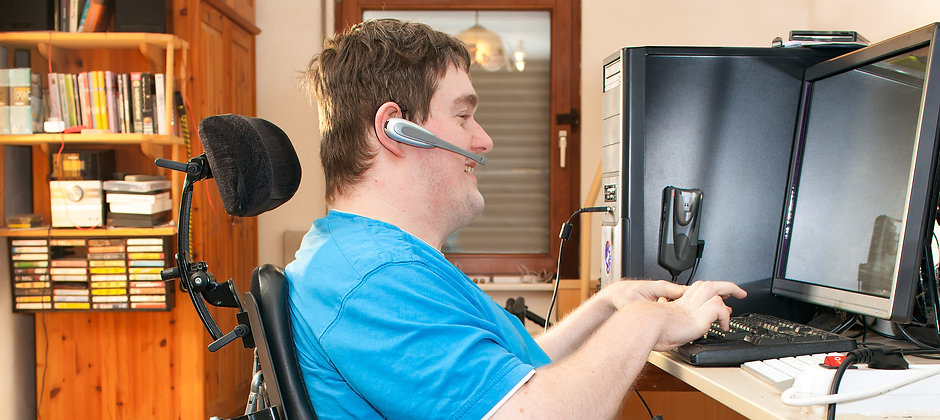 Man With Infantile Cerebral Palsy Using A Computer.jpg