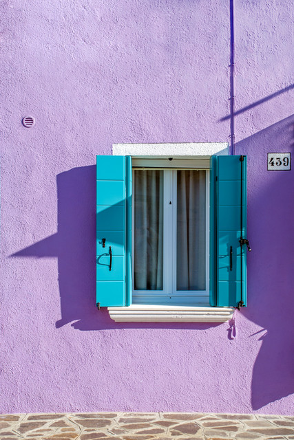 Colorful house with blue shutters