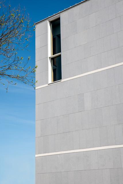 Grey building with a lonley window