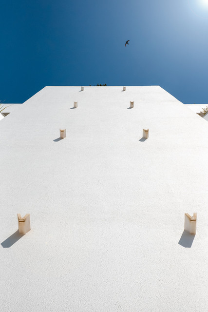 White building with a blue sky
