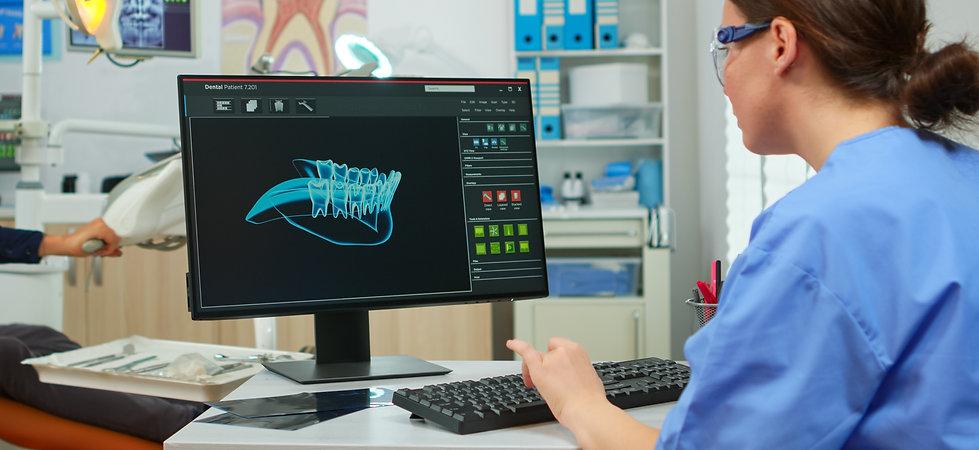 nurse-working-at-digital-dental-fingerpr