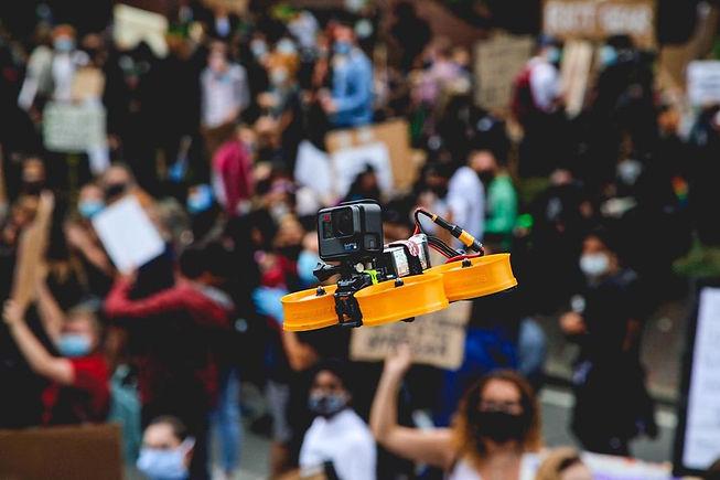 Cinewhoop FPV Drone flying over London crowd