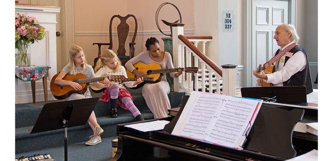 SWS Frank w children  & instruments.jpg