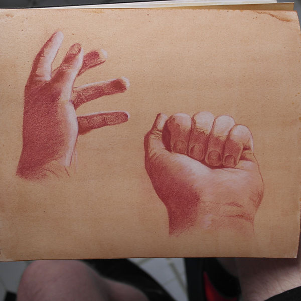 Draing in red chalk of two hands