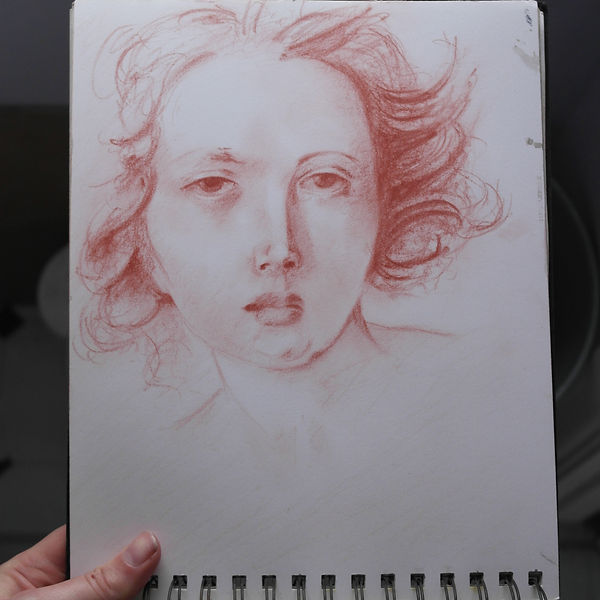Drawing of a woman in red chalk by Michael de Bono artist