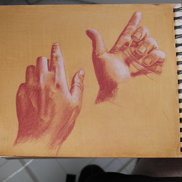 chalk drawing on prepared paper of hands pointing