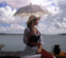 Michael de Bono figurative oil painting of a woman holding a parasol at the sea