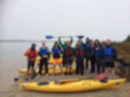Group of kayakers in Poole harbour
