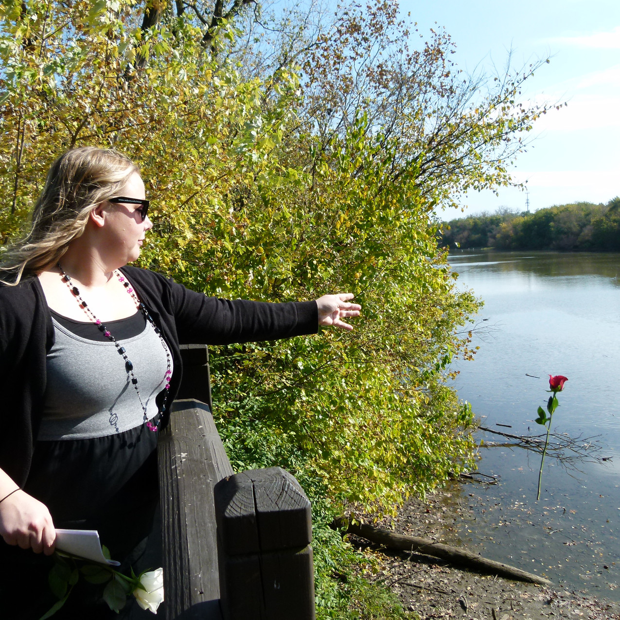 Kristine Oberlin tossing a rose