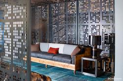Cut metal screen wall seating area