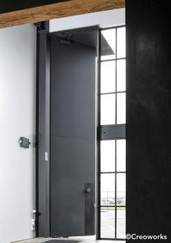 Custom blackened steel tall door