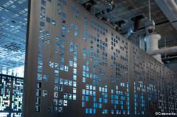 Intricately cut metal pattern wall