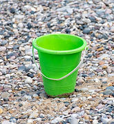 Close%20up%20of%20Green%20bucket%20or%20pail%20on%20the%20seashore%20sitting%20empty%20in%20the%20ro
