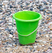 Close%2520up%2520of%2520Green%2520bucket%2520or%2520pail%2520on%2520the%2520seashore%2520sitting%252