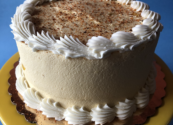 """the aries"" 6"" vanilla cake with mango icing and tajin topping"