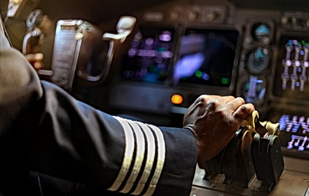 Cropped Hands of African Pilot flying a