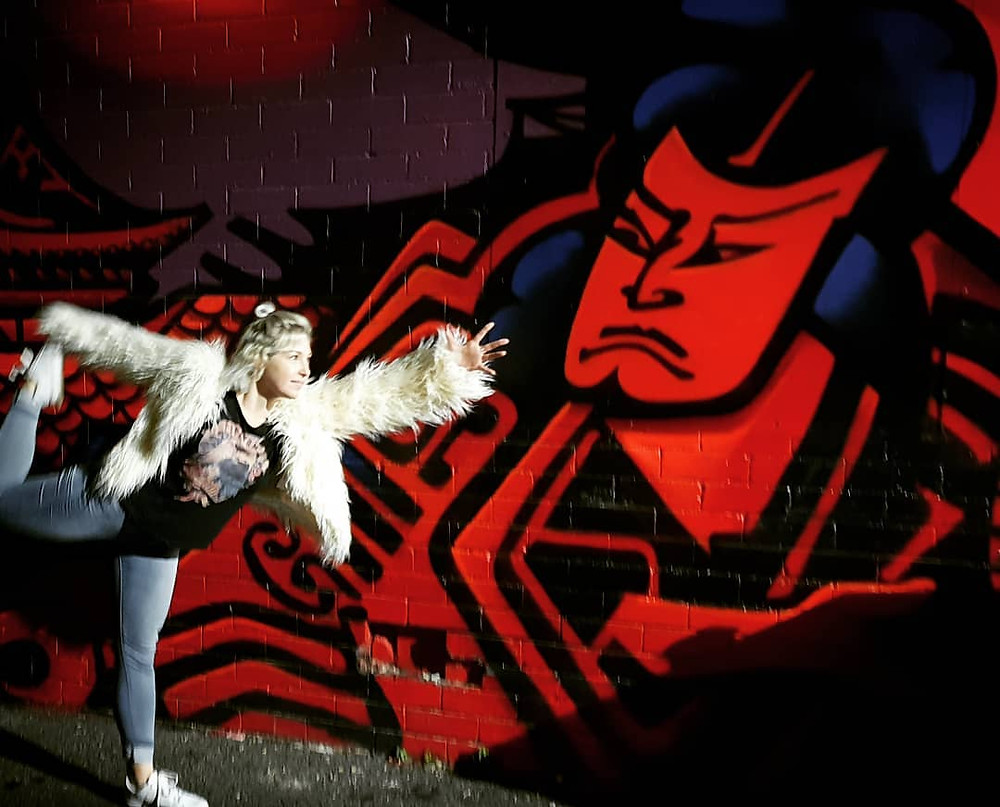 See Graffiti and strike a yoga pose