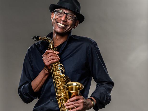 Smiling Man with Saxophone