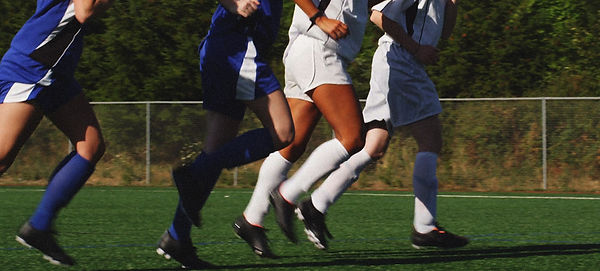 female-soccer-players-warm-up-before-a-g