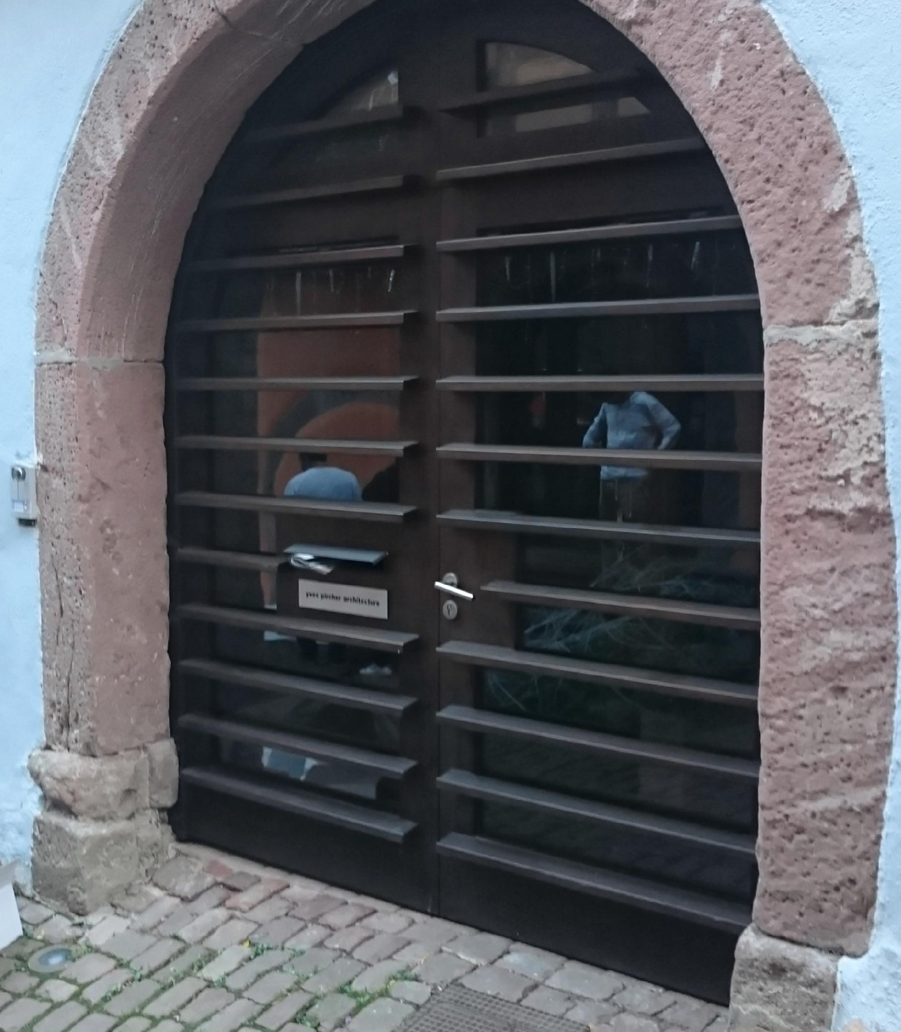 Porte cochère avec brise solail