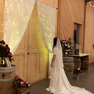 Barn Doors with Chiffon Curtains for Backdrop at Oak Hills Reception and Event Center