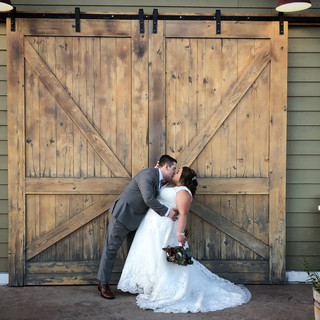 Newlywed Photos in Front of Barn Doors