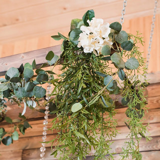 Mix of silk greenery and white flowers for Ladder Backdrop at Oak Hills Reception and Event Center