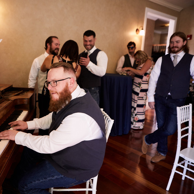 Antique Piano in the Ballroom at Oak Hills Reception and Event Center