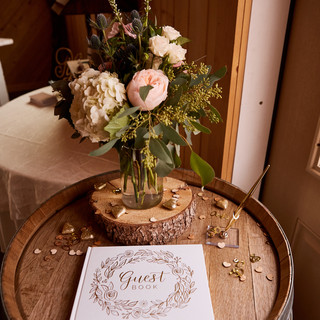 Barrels Used for Guest Sign In at Oak Hills Reception and Event Center Barn Venue