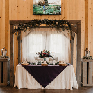 Rustic Wood Backdrop at Oak Hills Reception and Event Center