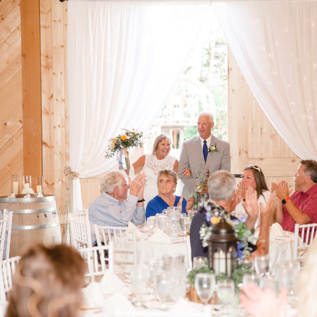 Newlywed Grand Entrance through Barn Doors at Oak Hills Reception and Event Center