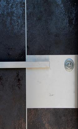 porta design acciaio brunito