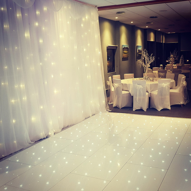LED Dance Floor and Starlit Backdrop