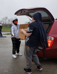 Phoenix Horizon's JAG students helped by loading boxes for families in need.