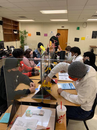 Phoenix Horizon students participate in the Lean Manufacturing Assembly Simulation line with help from Sam Matsumoto, Director at Consortium for Business Excellence.