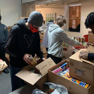 Phoenix Horizon Community JAG students take the opportunity to serve again at Amen House by packing supplemental boxes.